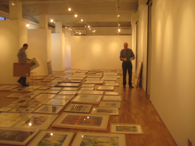 Laying out the paintings